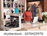 young smiling seller in store | Shutterstock . vector #1070425970