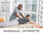 back massage. nice strong man... | Shutterstock . vector #1070432759