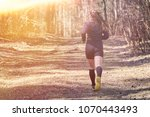 sporty girl in the woods from...   Shutterstock . vector #1070443493