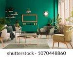 copper table on rug between... | Shutterstock . vector #1070448860