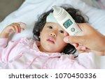 closeup mother hand takes... | Shutterstock . vector #1070450336