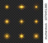 gold light effect. starburst... | Shutterstock .eps vector #1070451380