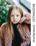 model kids.  little girl is... | Shutterstock . vector #1070463338
