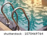 swimming pool with sunny. | Shutterstock . vector #1070469764