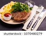 grilled beef steak served on... | Shutterstock . vector #1070480279
