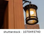 classic night lamp on wall... | Shutterstock . vector #1070493740