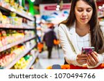 woman with smartphone in store. ... | Shutterstock . vector #1070494766