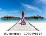 woman with raised hands on... | Shutterstock . vector #1070498819