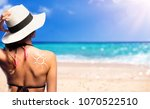 girl with suntan lotion shaped... | Shutterstock . vector #1070522510