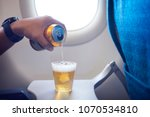 male hand pouring beer into a... | Shutterstock . vector #1070534810