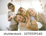portrait of young family at... | Shutterstock . vector #1070539160