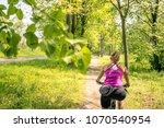 woman cycling a mountain bike... | Shutterstock . vector #1070540954