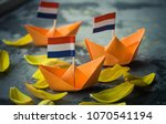 orange origami boats with dutch ... | Shutterstock . vector #1070541194