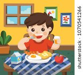 a little boy happy to eat... | Shutterstock .eps vector #1070541266