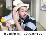 portrait of young man shouting... | Shutterstock . vector #1070554508