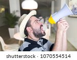 portrait of young man shouting... | Shutterstock . vector #1070554514