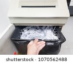 a hand is opening a tray of... | Shutterstock . vector #1070562488