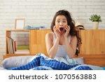 portrait of shocked asian woman ... | Shutterstock . vector #1070563883