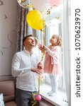 dad and daughter are posing at... | Shutterstock . vector #1070623970