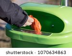 woman putting a excrement bag... | Shutterstock . vector #1070634863