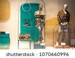 shop window. two mannequins... | Shutterstock . vector #1070660996