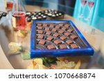 blue box with chocolate candies | Shutterstock . vector #1070668874