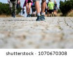 legs going on the stone road.... | Shutterstock . vector #1070670308