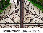 a closed forged metal gate... | Shutterstock . vector #1070671916