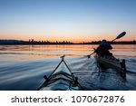 adventurous girl sea kayaking... | Shutterstock . vector #1070672876