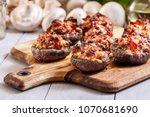 baked champignon caps stuffed... | Shutterstock . vector #1070681690