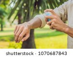 young man spraying mosquito... | Shutterstock . vector #1070687843