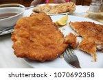 schnitzel lunch during austria... | Shutterstock . vector #1070692358