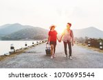 couple tourism backpack walking ... | Shutterstock . vector #1070695544