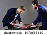 business partner signs the... | Shutterstock . vector #1070695610