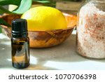 ripe yellow lemon green leaves... | Shutterstock . vector #1070706398