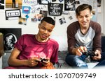 teenage boys hanging out in a... | Shutterstock . vector #1070709749