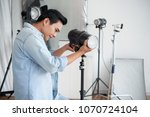 assistant of photographer... | Shutterstock . vector #1070724104