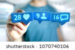 Small photo of View of a Businessman holding a Like, Follower and message notification on social network - 3d render