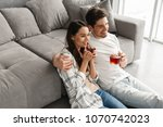 image of happy couple sitting...   Shutterstock . vector #1070742023