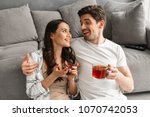 happy couple hugging and... | Shutterstock . vector #1070742053