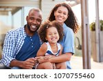 young black family embracing... | Shutterstock . vector #1070755460