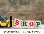 yellow toy forklift hold letter ... | Shutterstock . vector #1070759990