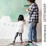 asian family renovating the... | Shutterstock . vector #1070760269