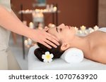 young woman receiving massage...   Shutterstock . vector #1070763920