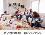friends with toddlers playing... | Shutterstock . vector #1070764403