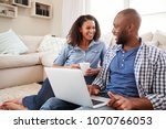 young black couple using laptop ... | Shutterstock . vector #1070766053