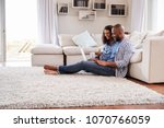 young black couple sit on the... | Shutterstock . vector #1070766059