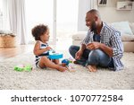 dad and toddler daughter... | Shutterstock . vector #1070772584