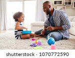 young black father playing with ... | Shutterstock . vector #1070772590