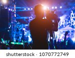 Cameraman shooting and recording video action film production professional digital camera videographer making in concert music festival at the party - stock photo